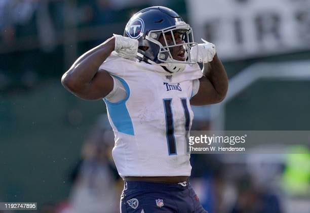 Brown of the Tennessee Titans celebrates after he scored a touchdown against the Oakland Raiders during the first half of an NFL football game at...