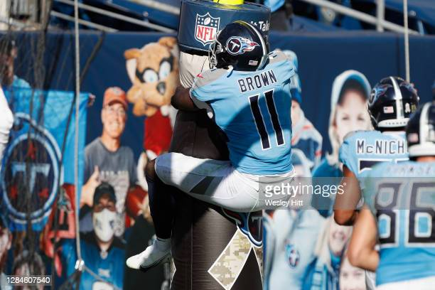 Brown of the Tennessee Titans hugs the goal post after a first half touchdown against the Chicago Bears at Nissan Stadium on November 08, 2020 in...