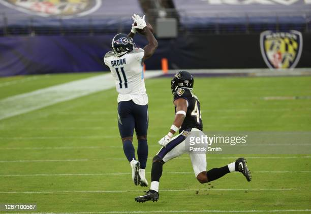 Brown of the Tennessee Titans makes an overtime catch against Marlon Humphrey of the Baltimore Ravens during the game at M&T Bank Stadium on November...