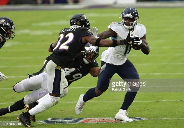 Brown of the Tennessee Titans runs against DeShon Elliott of the Baltimore Ravens during the game at M&T Bank Stadium on November 22, 2020 in...