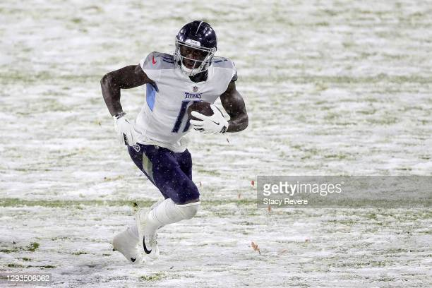 Brown of the Tennessee Titans runs for yards during a game against the Green Bay Packers at Lambeau Field on December 27, 2020 in Green Bay,...