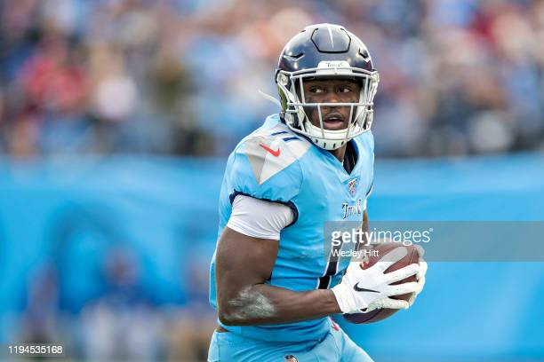 Brown of the Tennessee Titans runs the ball after catching a pass during a game against the Houston Texans at Nissan Stadium on December 15, 2019 in...