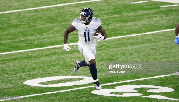 Brown of the Tennessee Titans runs the ball against the Indianapolis Colts at Lucas Oil Stadium on November 29, 2020 in Indianapolis, Indiana.