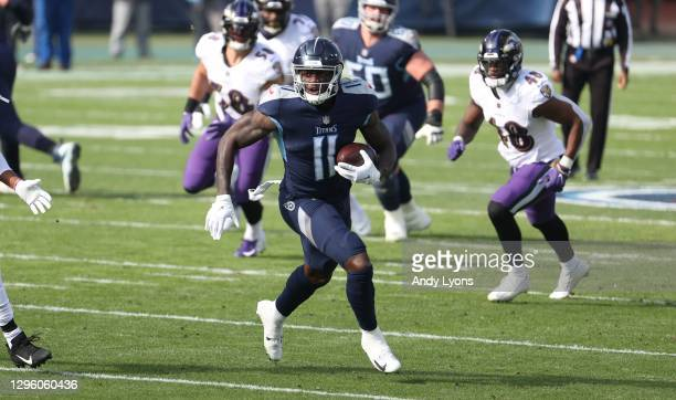Brown of the Tennessee Titans runs with the ball against the Baltimore Ravens in the Wild Card Round of the NFL Playoffs at Nissan Stadium on January...