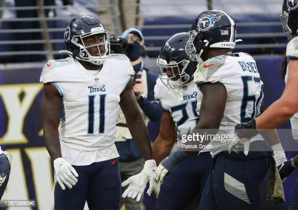 Brown of the Tennessee Titans scores a fourth quarter touchdown against Patrick Queen of the Baltimore Ravens during the game at M&T Bank Stadium on...