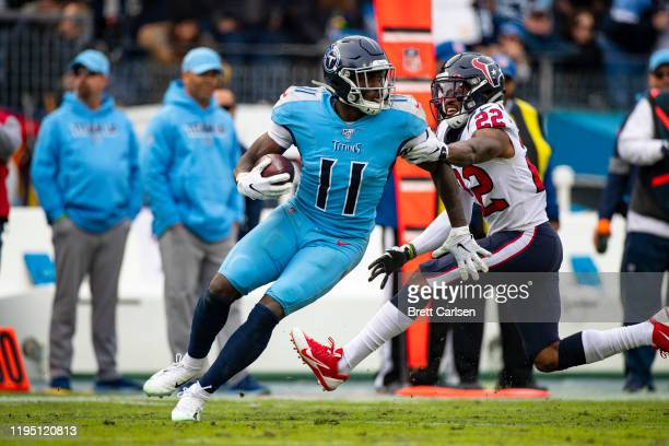 Brown of the Tennessee Titans spins with a pass reception against Gareon Conley of the Houston Texans during the third quarter at Nissan Stadium on...