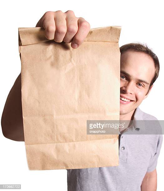 Brown paper bag handed over by man