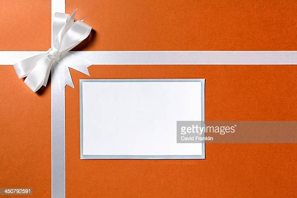 Brown paper package with white ribbon and label