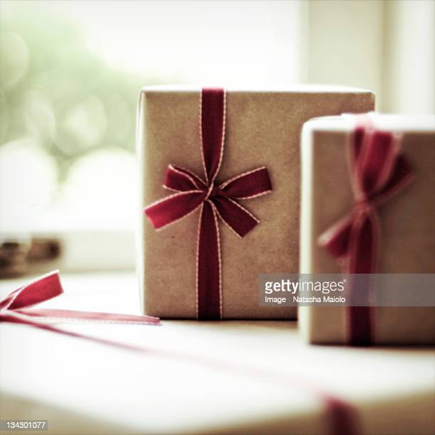 Brown paper packages tied up with red ribbon