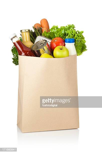brown paper shopping bag full of groceries on white backdrop - shopping bag stock pictures, royalty-free photos & images