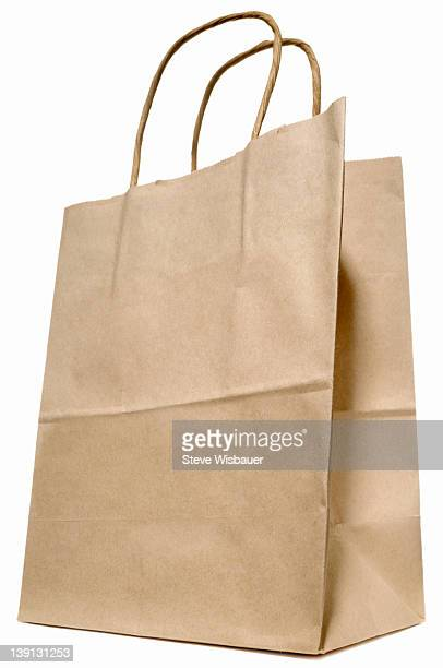 A brown paper shopping bag with handles