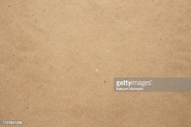 brown paper texture background - vakmanschap stockfoto's en -beelden