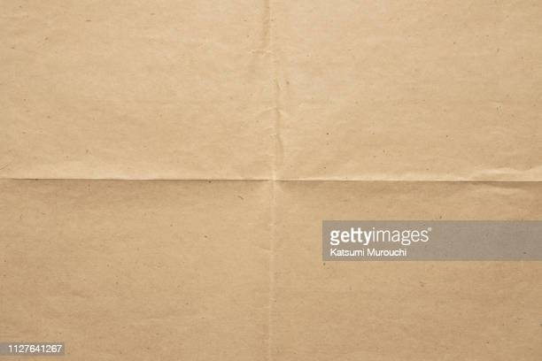 brown paper texture background - folded stock photos and pictures
