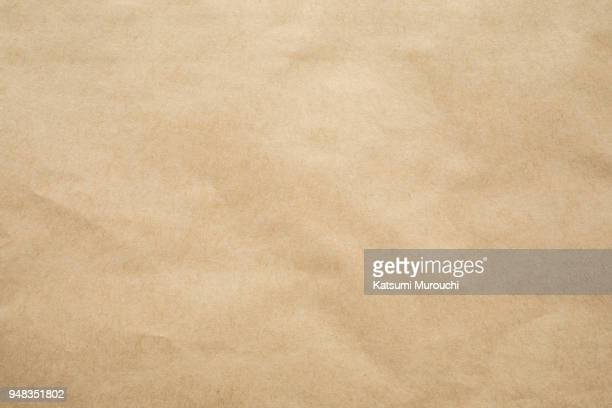 brown paper texture background - beige stock-fotos und bilder