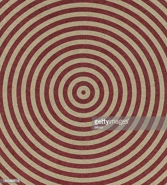 brown paper with spiral target pattern