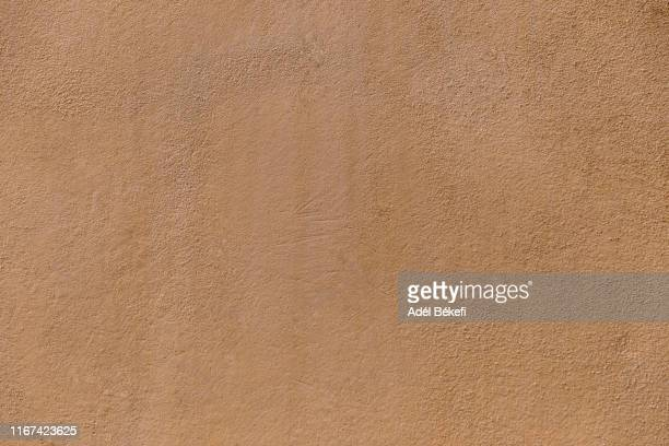 brown plastered  concrete wall - natural condition stock pictures, royalty-free photos & images