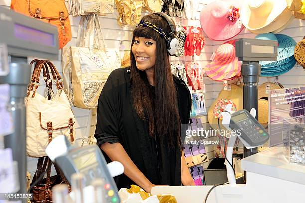 Brown poses during her DJ set at the Claire's New Shop Inauguration on May 30 2012 in Paris France