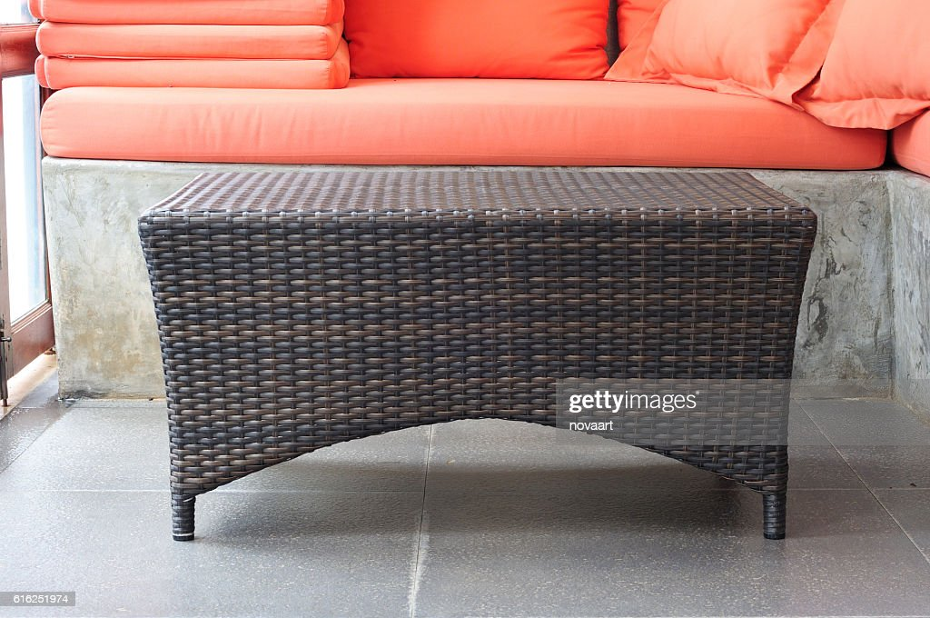 Brown rattan coffee table with sofa loft style : Stock Photo