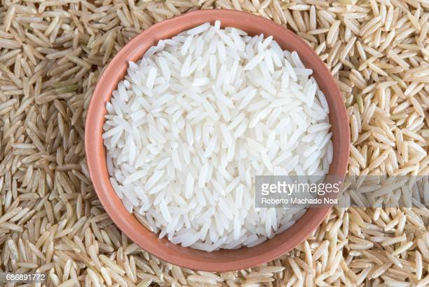 Brown rice and white rice contrasted According to dietitians the brown rice which is higher in fiber offers more benefits to health