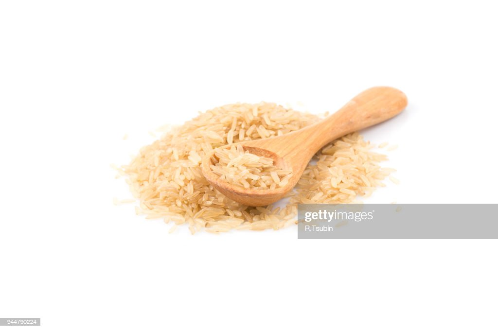 brown rice in spoon : Stock Photo