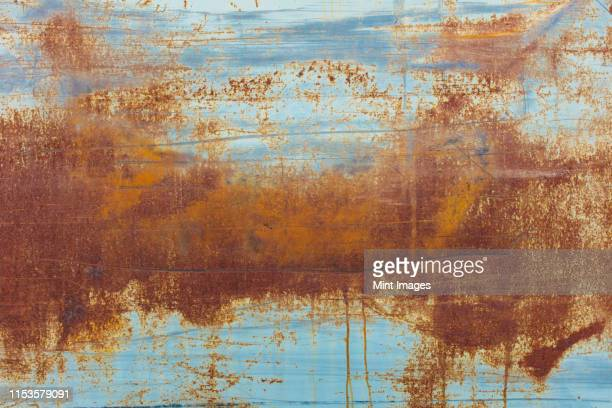 brown rusting patches on an old wall - rusty stock pictures, royalty-free photos & images