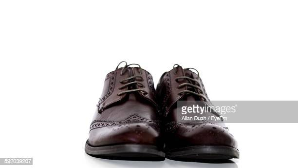 brown shoes against white background - pair stock pictures, royalty-free photos & images