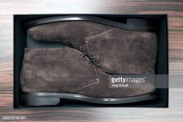 Brown shoes in box, close-up