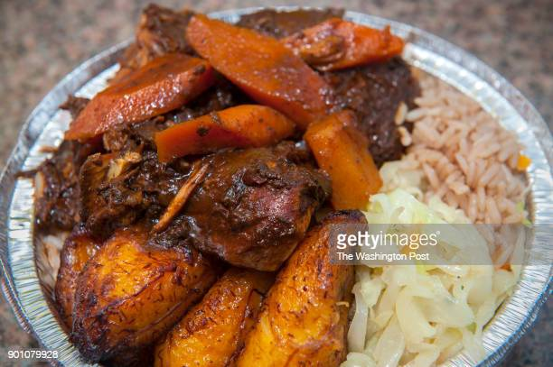 Brown stew chicken served with plaintains cabbage and rice is photographed Monday September 9 2013 in Lanham MD Philip Ajaj and Pierre Stone played...