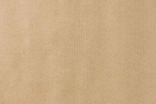 Brown striped recycle paper texture for wraping. Kraft paper 854538780