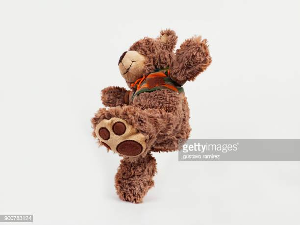 brown stuffed bear kicking - teddy bear stock pictures, royalty-free photos & images