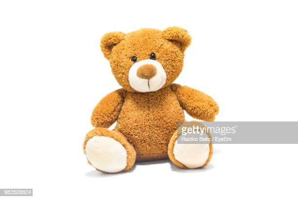 brown stuffed toy over white background - stuffed toy stock pictures, royalty-free photos & images