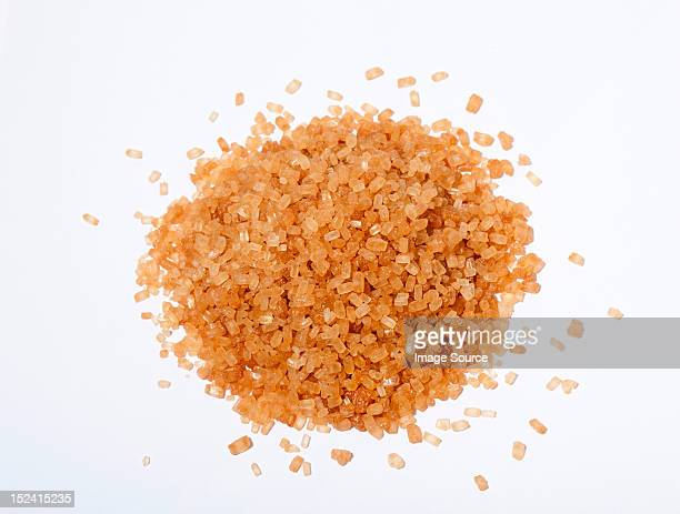 brown sugar crystals - sugar pile stock pictures, royalty-free photos & images