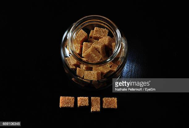 brown sugar cubes with glass jar on table - nathalie pellenkoft stock pictures, royalty-free photos & images