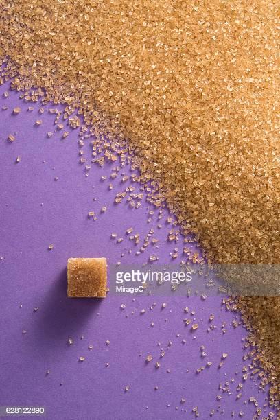 Brown Sugar on Purple Background