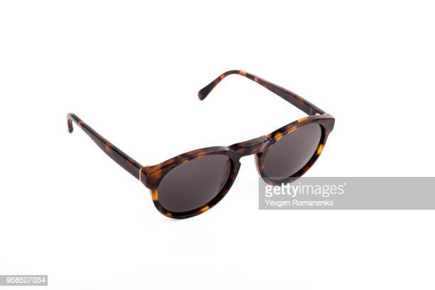 brown sunglasses isolated on white background - sunglasses stock pictures, royalty-free photos & images