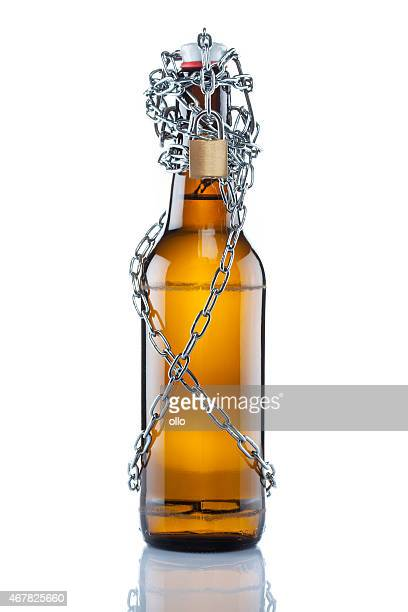 Brown swing top beer bottle in chains