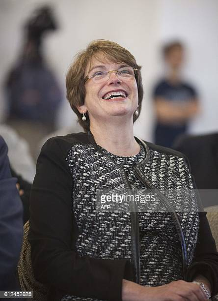 Brown University President Christina Paxson watches as Physics professor J. Michael Kosterlitz addresses Brown University facutly and students via...