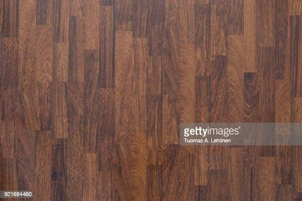 Brown wood laminate flooring texture background in house.