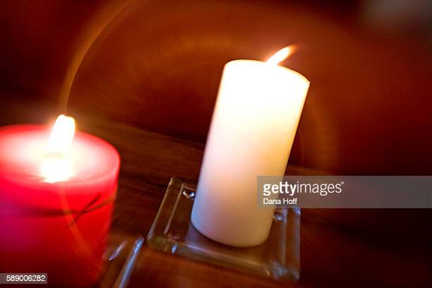 brown wood table with lit red and white candles - dana white stock pictures, royalty-free photos & images