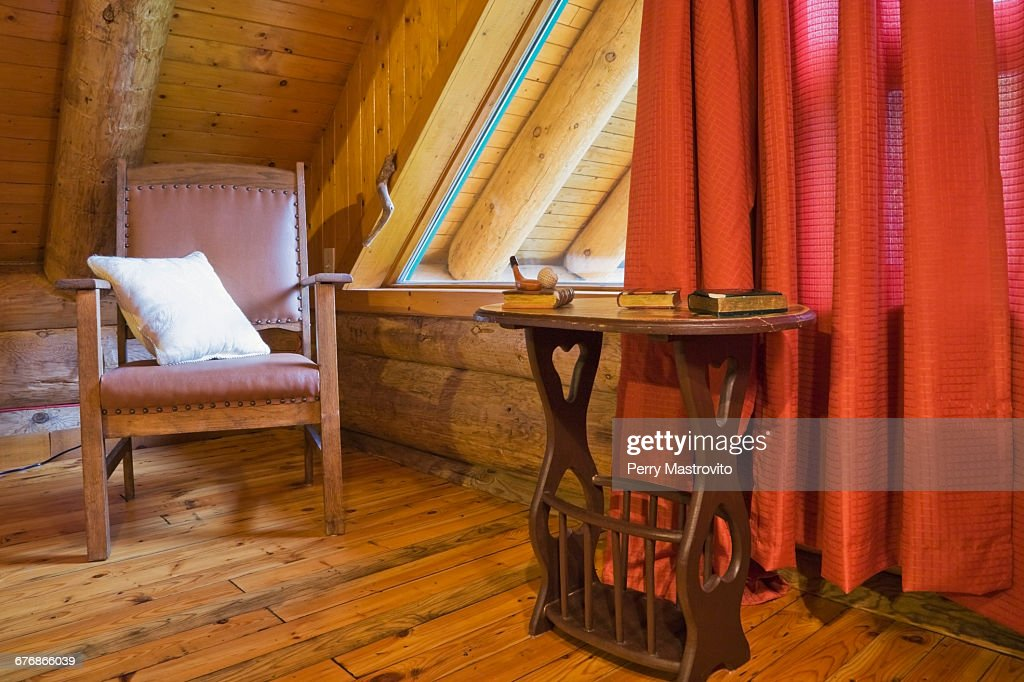 Brown Wooden Leather Chair And Side Table In Master Bedroom In Scandinavian Cottagestyle Log Home Quebec Canada High Res Stock Photo Getty Images