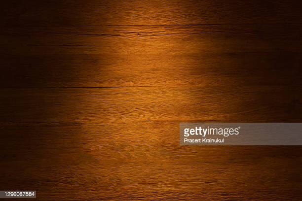 brown wooden plank desk table background texture top view. - wood material stock pictures, royalty-free photos & images
