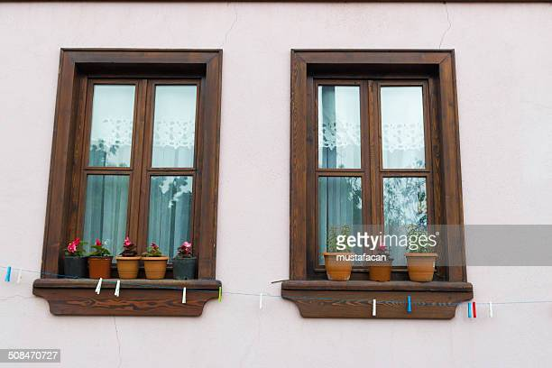 Brown wooden windows in a pink house