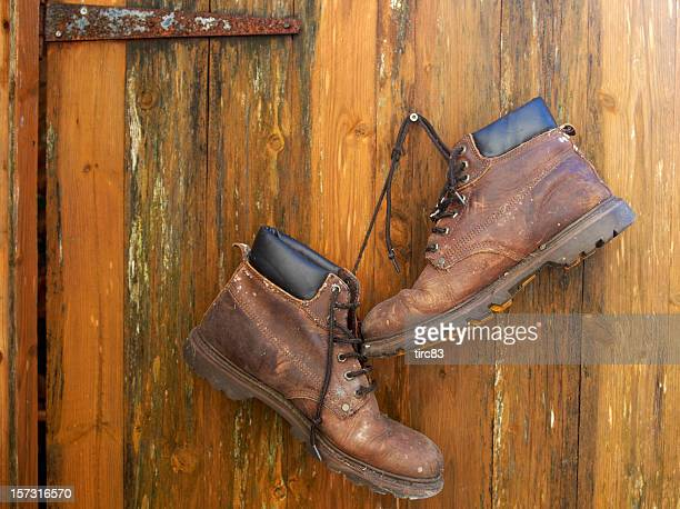 Brown workboots hanging on a nail