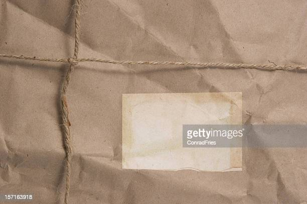 Brown Wrapped Package with Label