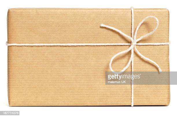 brown wrapped parcel - string stock pictures, royalty-free photos & images