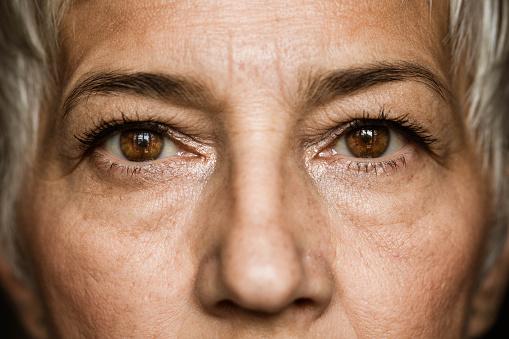 Brown-eyed senior woman. 1175240111
