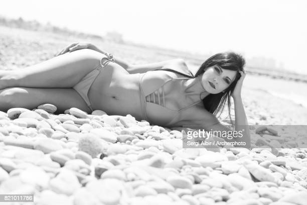 Brown-haired girl in a pebbles beach