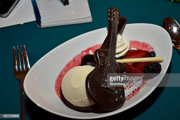 Brownie sundae served in ZZ Top-themed chocolate guitar cases sits on the table at the eighth annual Everglades Foundation benefit at the Breakers...