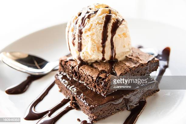 brownie with vanilla ice cream - brownie stock pictures, royalty-free photos & images