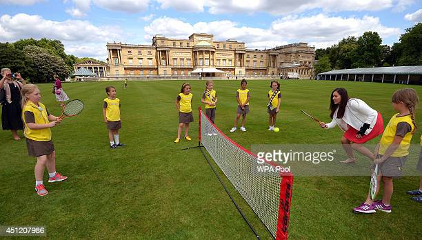Brownies play tennis with injured British tennis player Laura Robson at a tea party hosted by Sophie Countess of Wessex at Buckingham Palace London...